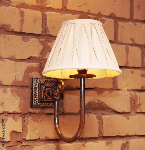 Lamp on the brick wall