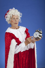 Mrs Claus showing Santa the time so he isn't late for Christmas