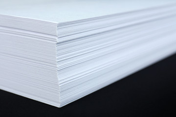 White paper on black background close-up