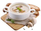Mushroom soup in white bowl, on napkin, isolated on white