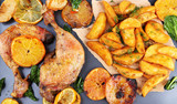 Homemade roasted chicken drumsticks with fried potatoes and