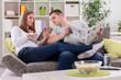 Enjoying family on sofa