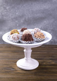 Set of chocolate candies on table on grey background