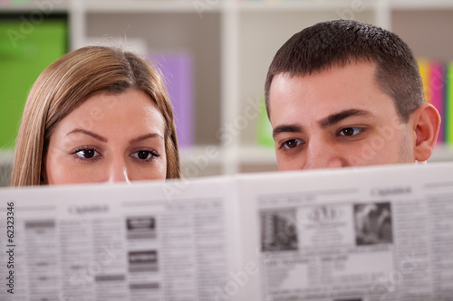 Couple reading news