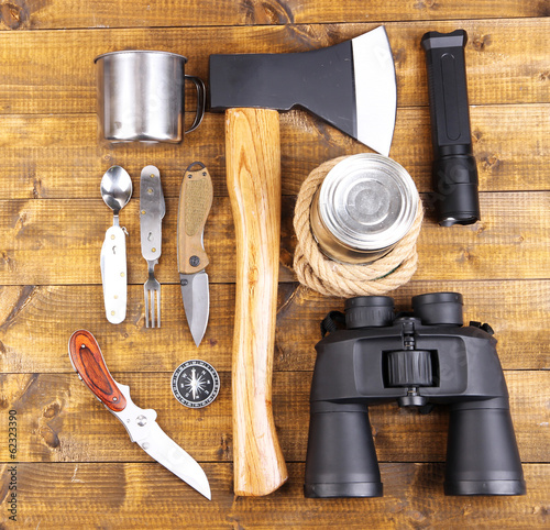 Equipment for trekking on wooden background