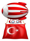 The flag of Turkey attached to the floating balloon