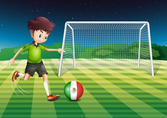 A boy kicking the ball with the flag of Mexico