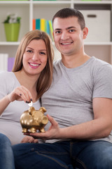 Smiling couple putting coin