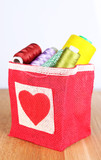 Colorful bobbins of thread  in bag,