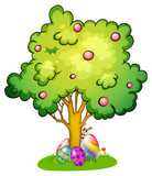 A bunny and eggs under the tree