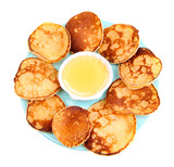 Fried pancakes on color plate, isolated on white