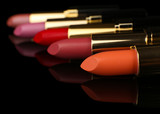 Beautiful lipsticks on black background