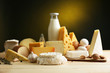Tasty dairy products on wooden table, on dark background - 62324798