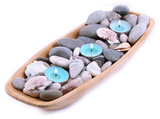 Wooden bowl with Spa stones, sea shells and candles isolated