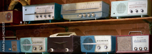 vintage radio on a wooden shelf (toned image ) - 62325317