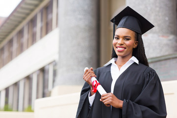 african female student with graduation certificate