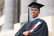 african american male graduate standing outside college
