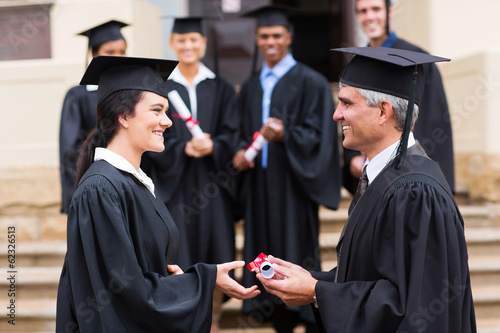 young graduate receiving diploma