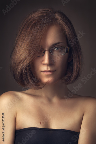 portrait wearing spectacles