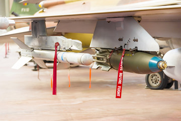 Two Military Rockets Under Airplane Wing Ready for the Action