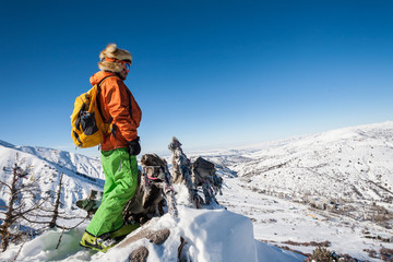 People on winter vacation, skiing and snowboarding, a lot of joy