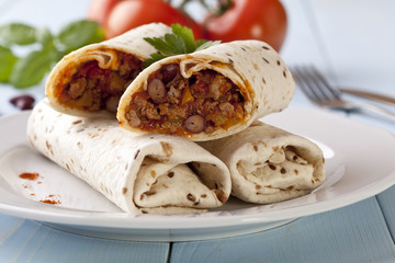 burritos wraps with meat beans and vegetables
