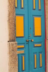 door painted blue and yellow,portugal europe