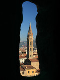 Badia Fiorentina  church seen through old stone window