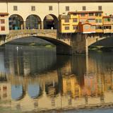 scene with famous Ponte Vecchio over Arno river in Florence