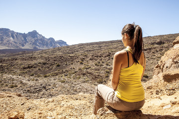 young woman enjoyng a beautiful desert scenic view