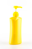 Yellow bottle pump isolated on white background