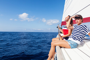 Happy women on the bow of a Sail Boat. Copy space