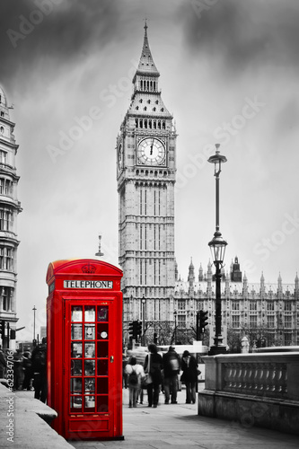 Red telephone booth and Big Ben in London, England, the UK. - 62334706