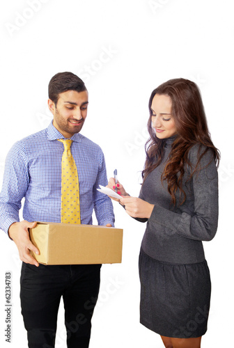 Woman signing for courier, delivery man in background