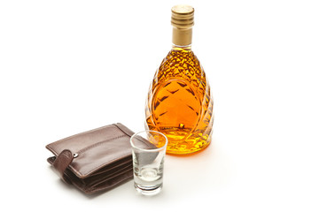 Glass bottle of brandy wallet and small glass