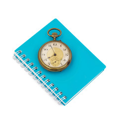 notebook with old clock vintage on white background
