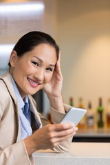 Closeup portrait of a businesswoman text messaging