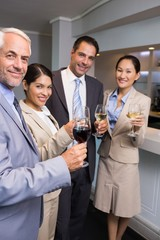Business colleagues with wine glasses at office