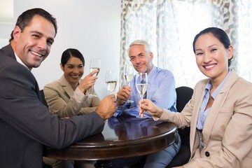 Business colleagues toasting wine glasses