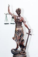 back of themis, femida or justice goddess sculpture on white