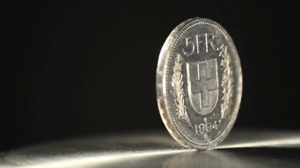5 swiss franc coin rotating.  Find similar clips in our portfoli