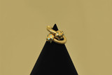 Vintage jewelry on cone gold background