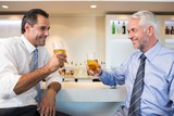 Business colleagues having beer at bar counter