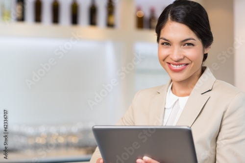 Portrait of a smiling young businesswoman holding digital tablet