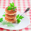 Fresh chicken cutlets with herb on white plate, selective focus