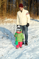Dad walks with a young child