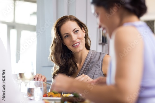 Beautiful woman having food with friend at restaurant