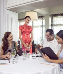 Business colleagues around dining table in restaurant