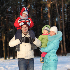 young family walks winter