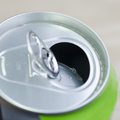 fore the closure of an aluminum can of soda